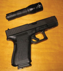 The author's clearing tools of choice: Glock 19 9mm handgun and SureFire G2X Tactical light.