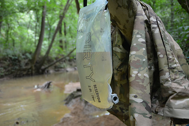 The Platypus Bag system has a simple attachment system to hang your bag of water to be treated up on a tree, bumper or anything higher than the clean bag. Gravity does all the hard work.