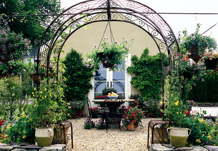 Dwarf, container, trellis and espalier fruit can transform a compound into a more pleasant space, allow perennial production in urban and suburban environments, and let us take our fruit trees and shrubs with us when we move.