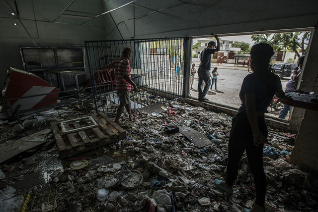Stores are quickly cleaned out in Venezuela's food riots.