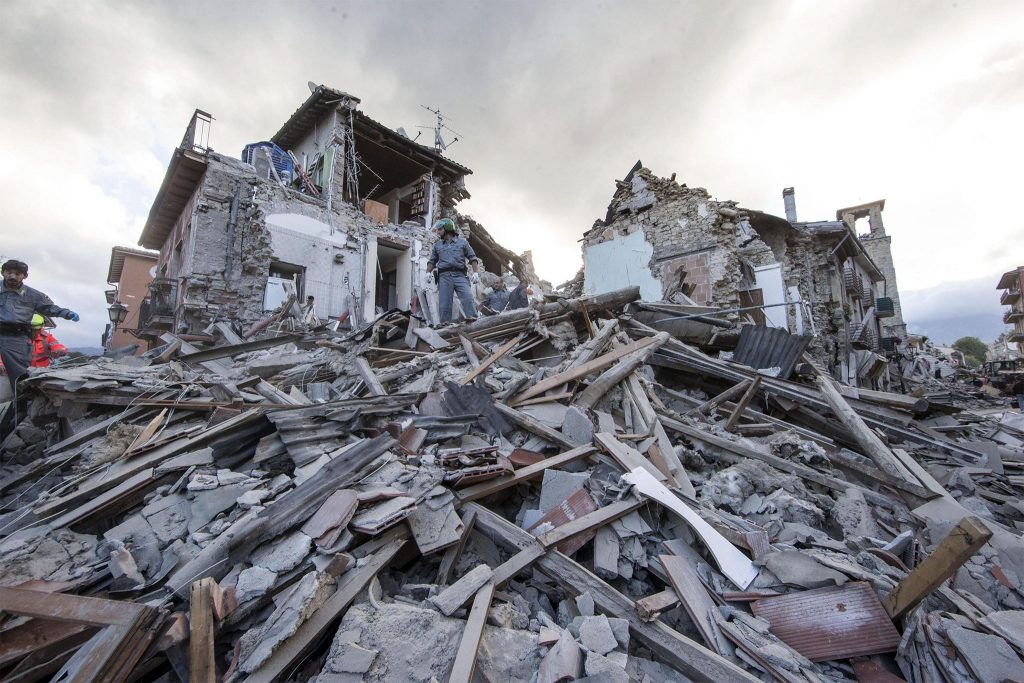 Search and rescue teams survey the rubble in Amatrice, central Italy, 24 August 2016, following a 6.2 magnitude earthquake