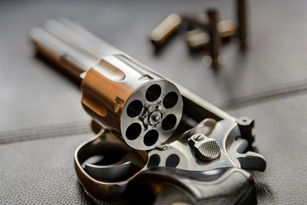 Even a cheap revolver is going to shoot a round that fits correctly in a cylinder chamber. New ammo or reloads, it does not matter.
